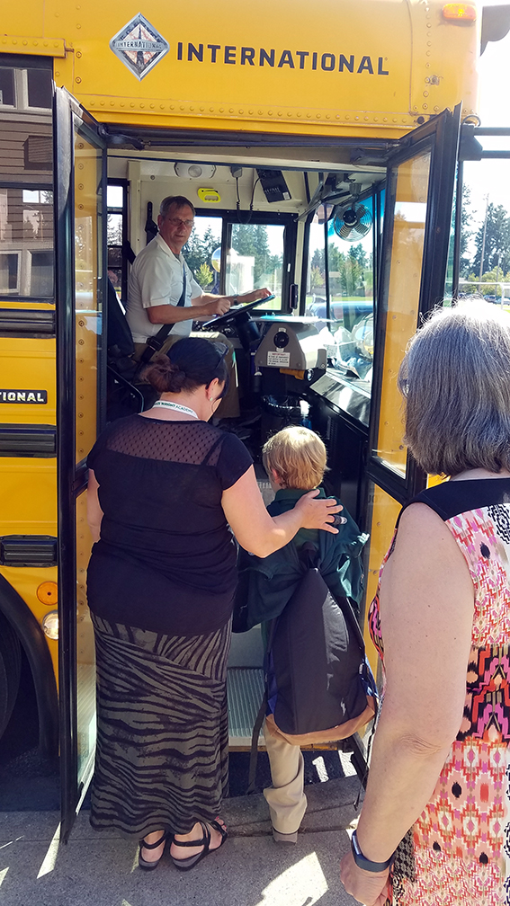 student boards a charles wright academy bus