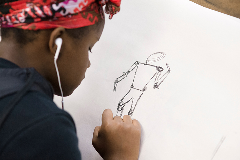 upper school student in a life drawing class