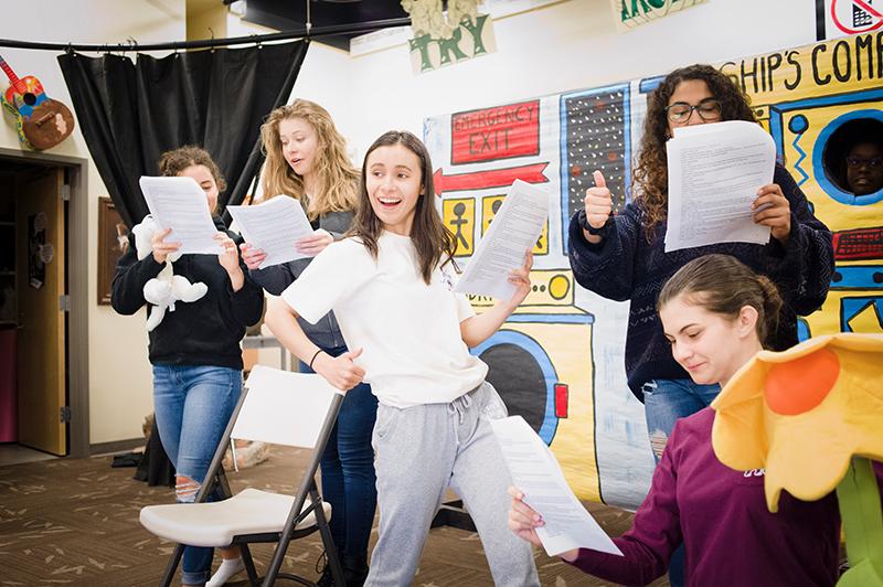 upper school drama students rehears