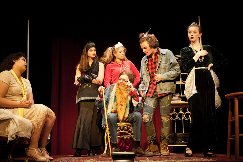 upper school students perform a play onstage