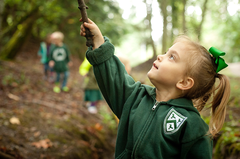 Preschool student in the Charles Wright campus forest